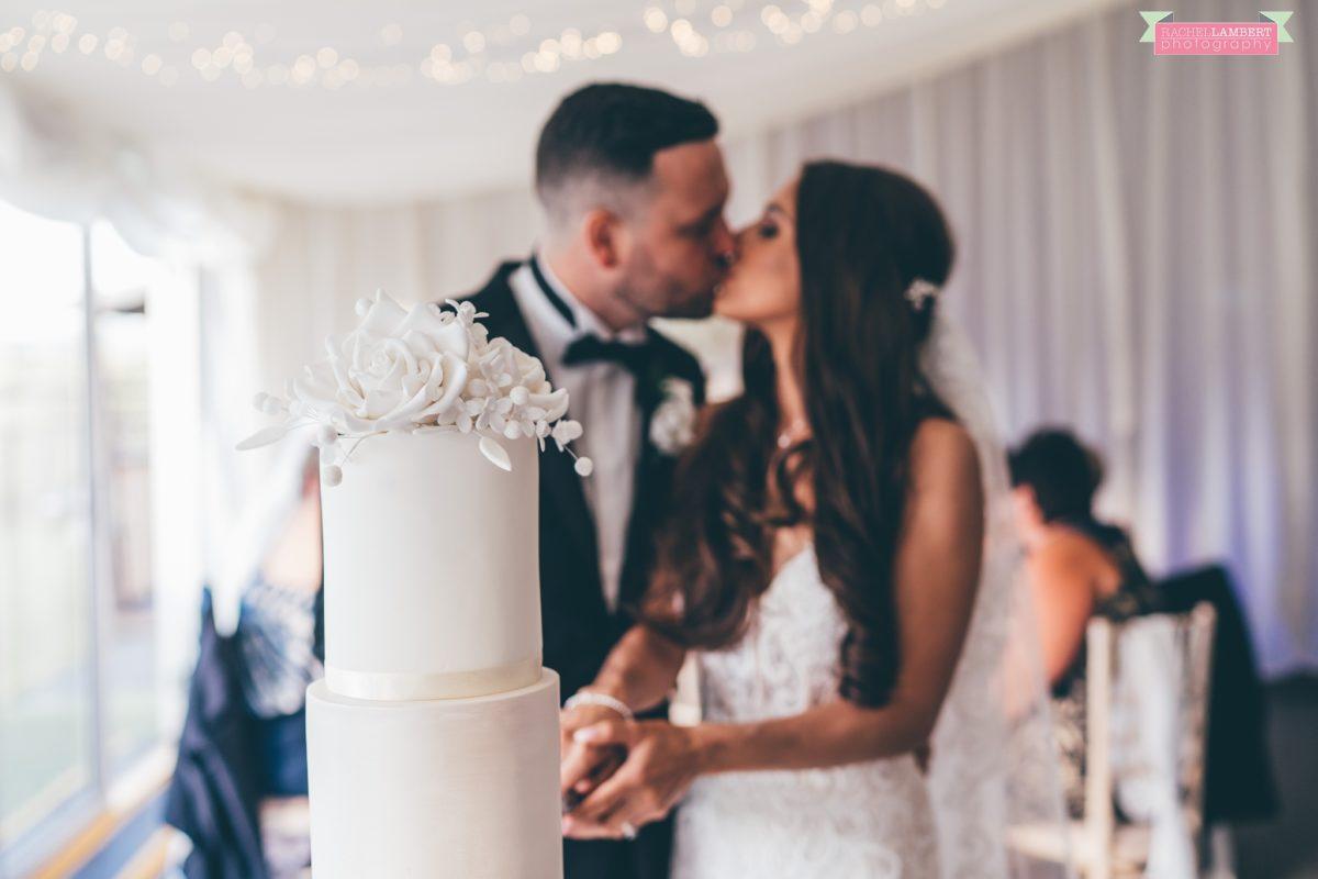 Cardiff Wedding Photographer Llanerch Vineyard rachel lambert photography cutting the cake
